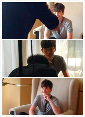 Greyson Chance doing press in a very large chair in Beijing