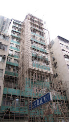 Building covered in bamboo scaffolding.