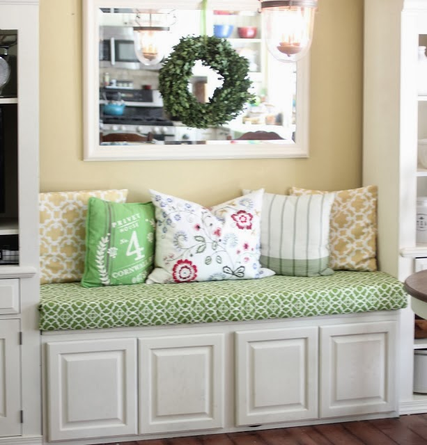 Kitchen eating nook bench with no sew cushion cover and 2 upper cabinets via www.goldenboysandme.com
