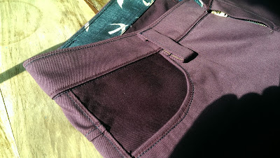 waistband and pocket detail on purple seagull jeans