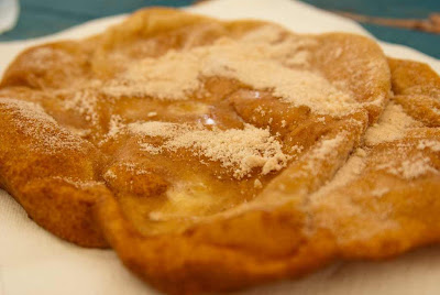 Elephant Ear - fried disc of dough, rolled in cinnamon sugar.