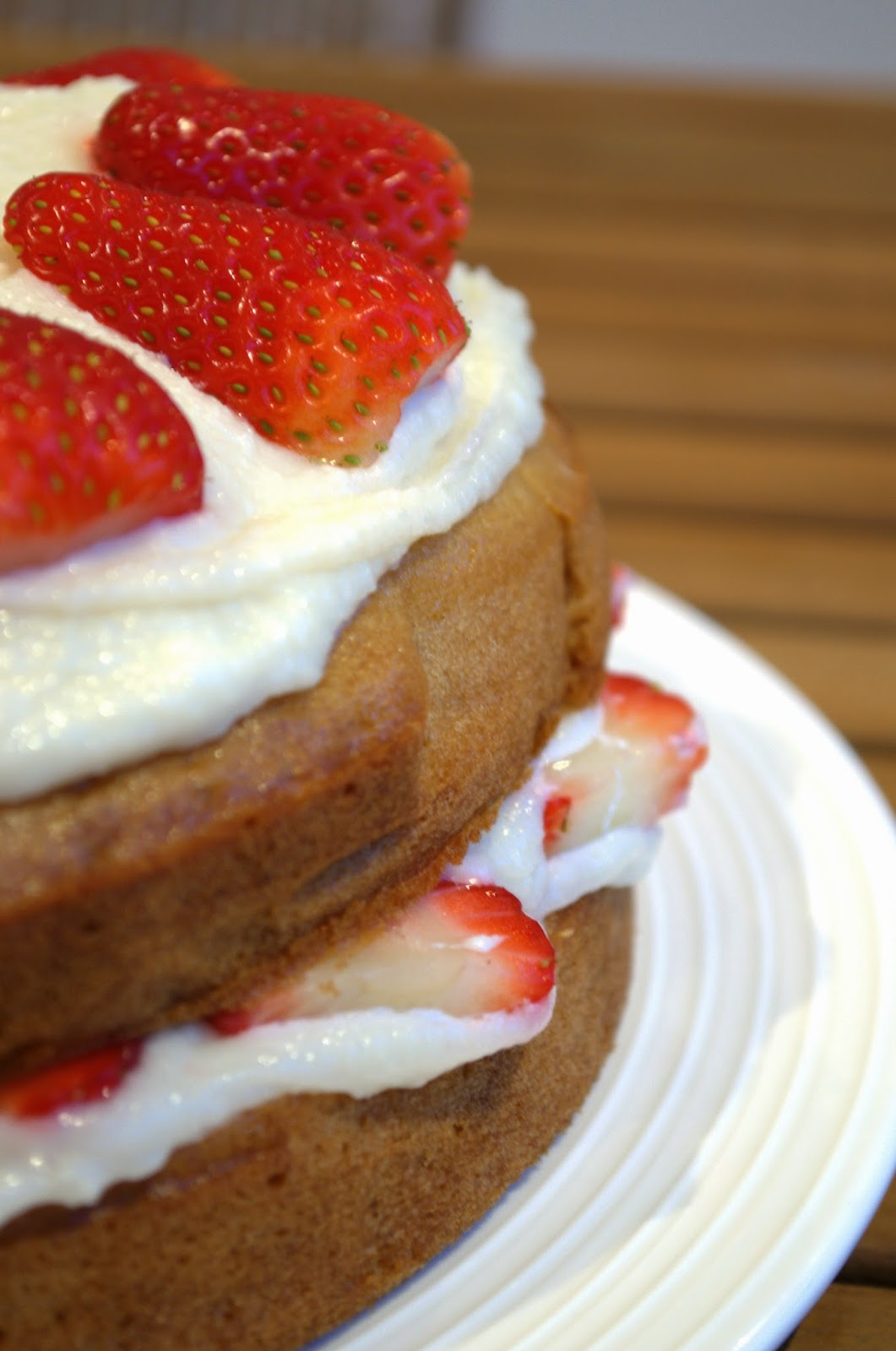 Vegan sponge cake with buttercream frosting and strawberries