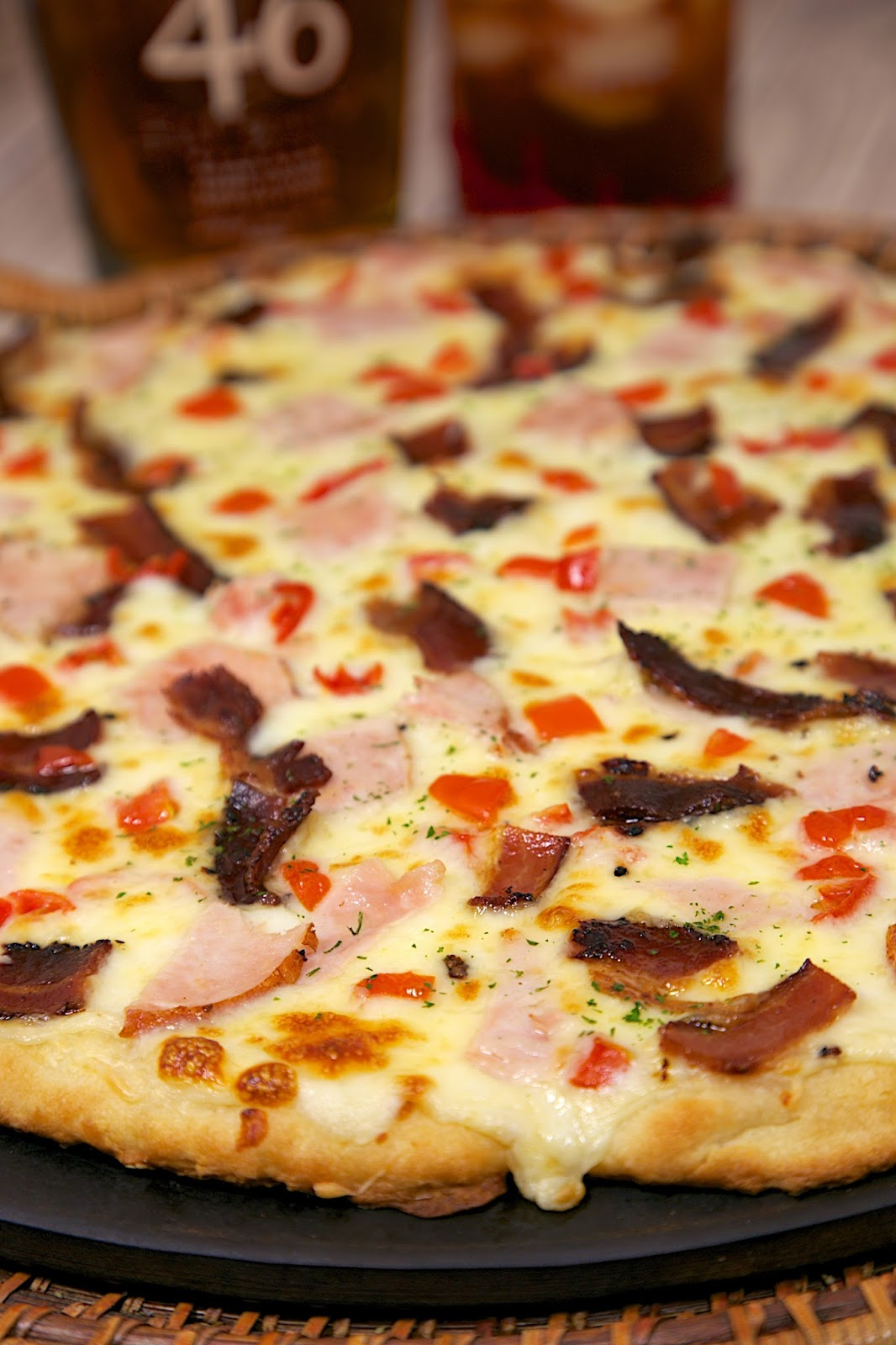 Hot Brown Pizza Recipe - mornay sauce(swiss cheese sauce), turkey, tomatoes, bacon, swiss and mozzarella cheese - perfect for watching the Kentucky Derby!