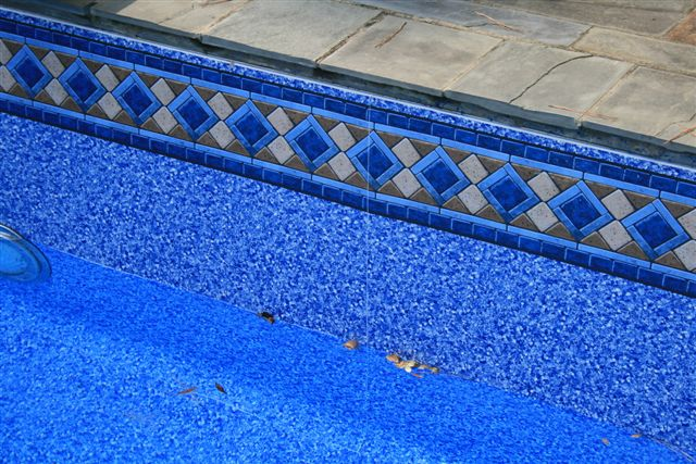 How to remove white spots calcium deposits from a pool for Pool liners