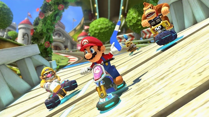 Screenshot of Mario Kart 8. The title character is using the anti-gravity feature of his vehicle to cling to a twisted bridge. He is holding a boomerang, while Wario and Donkey Kong are right behind him.