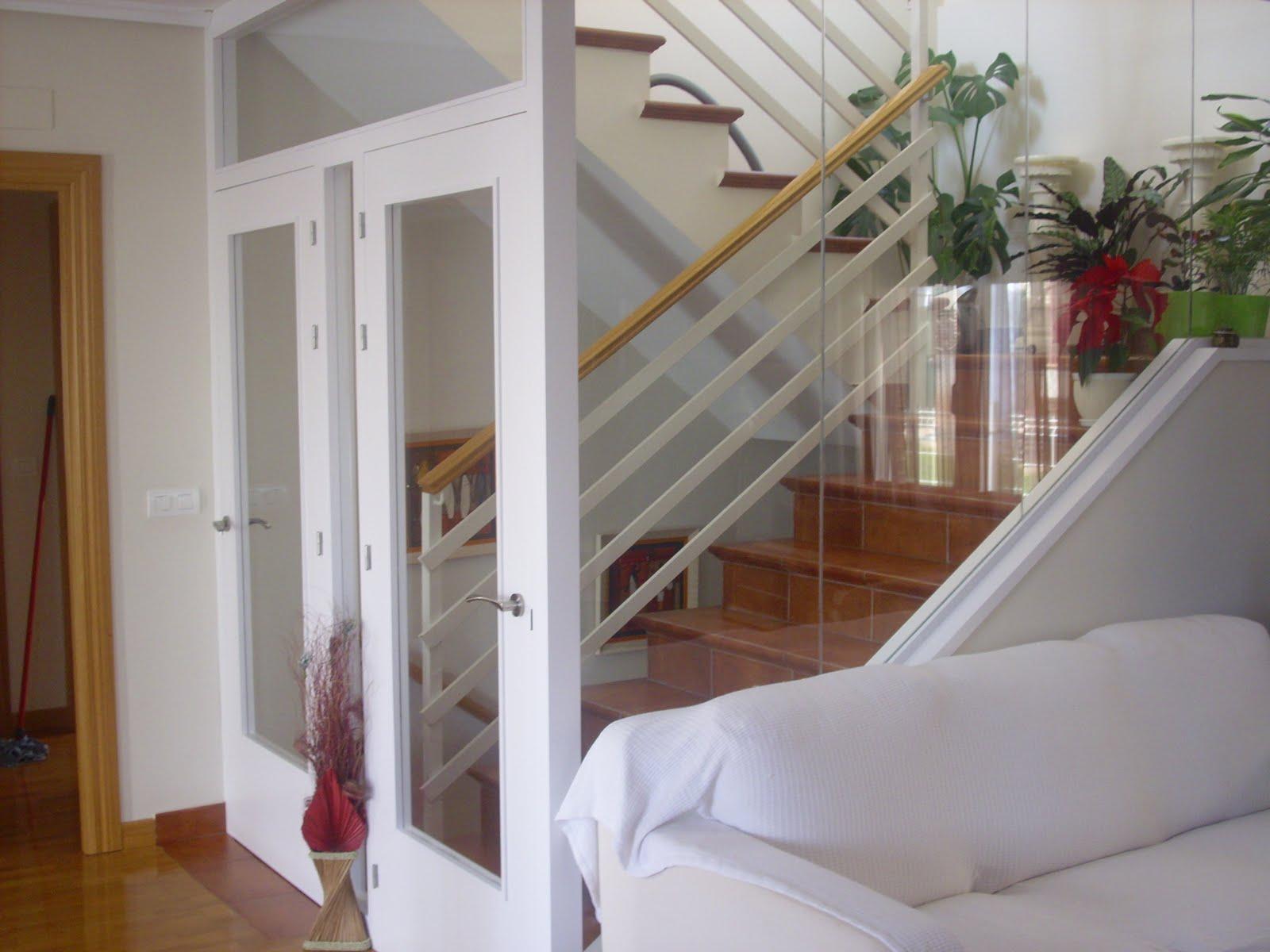 El carpintero cerramiento de huecos de escalera for Huecos de escaleras modernos