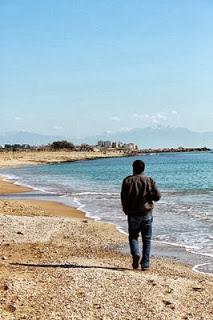 Alone boy near river sea in love