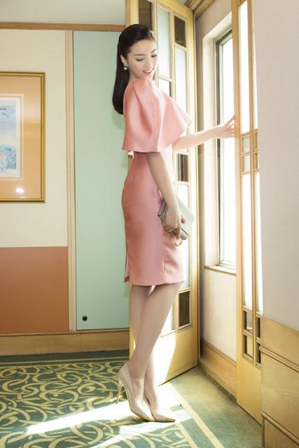 Hoa hậu Việt Nam 2014 khoe vẻ trẻ trung với đầm hồng lãng mạn