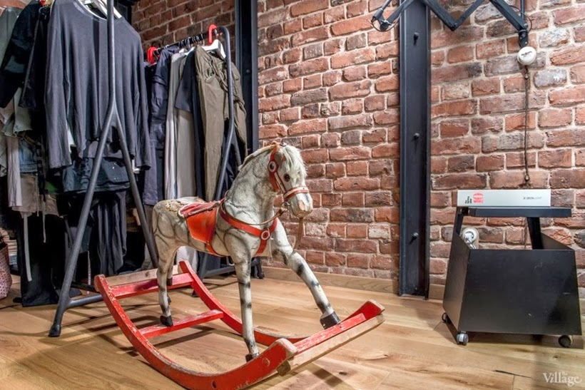 Horse toy in Industrial interior design duplex apartment in Moscow