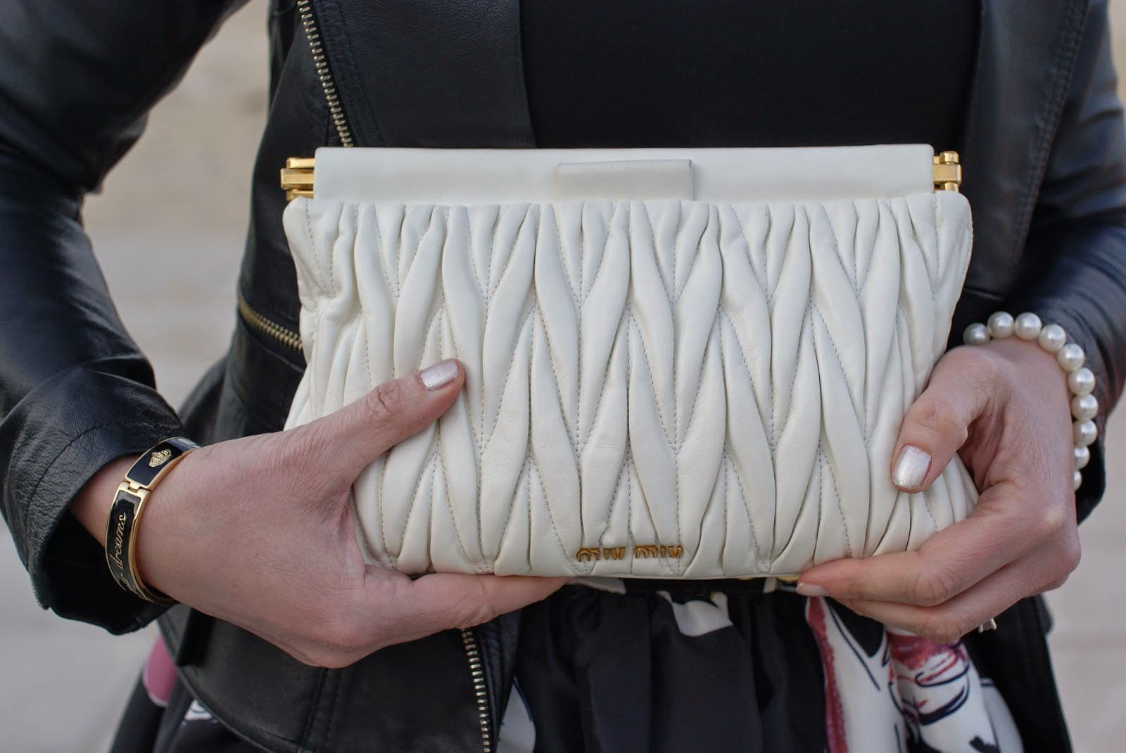 Miu Miu quilted clutch and Chanel Paradisio nail polish