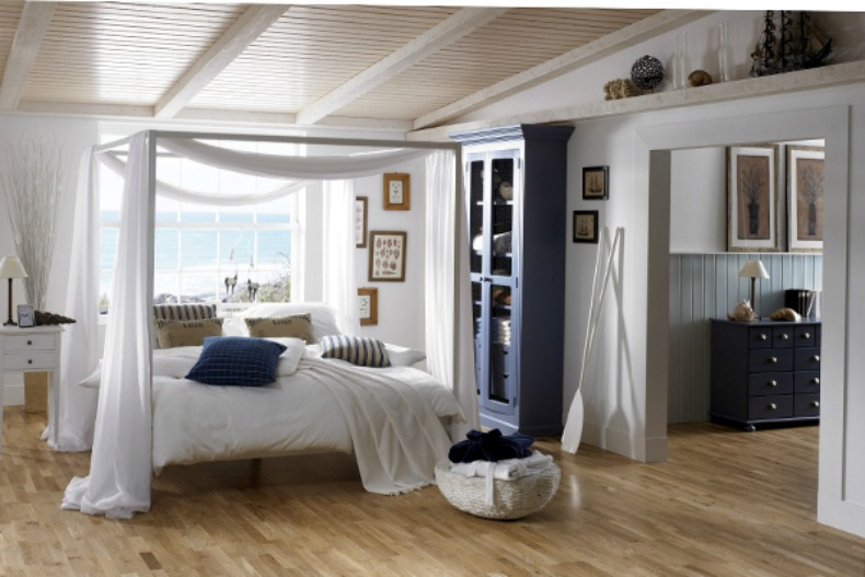 White bedding against the wicker nightstands gives great contrast while the four post canopy bed draped in gauze reminds you of the islands. & Inspirations On The Horizon: Coastal Bedrooms