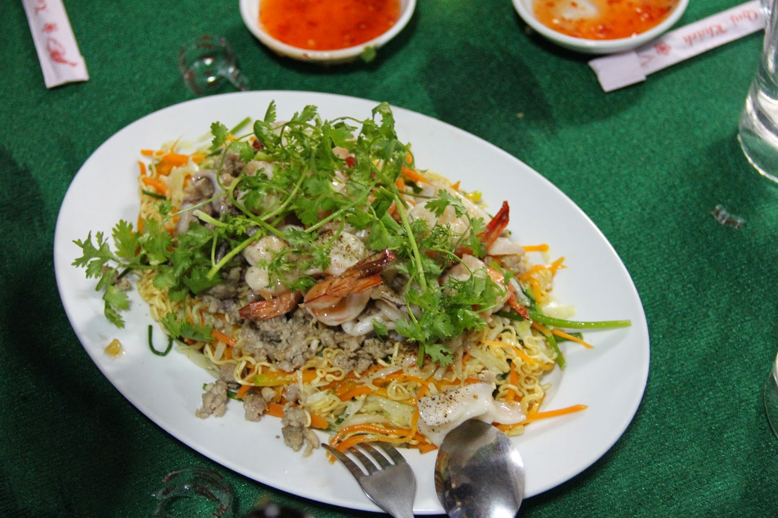 Delicious seafood and noodles dish for dinner at a private home in Chau Doc, Vietnam.