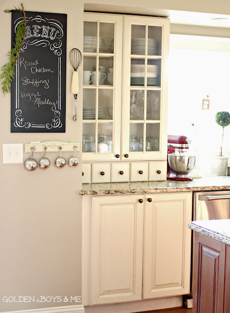 Kitchen hutch with chalkboard menu and hanging measuring cups-www.goldenboysandme.com