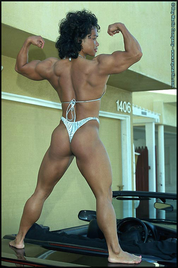 Dawn Riehl Flexing Her Biceps And Modeling Her Great Backside On A Car