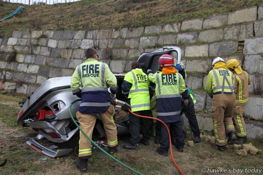 The Lowe Corporation Rescue Helicopter was called to Waimarama Road after a woman tipped her vehicle off the road, crashed through a fence and rolled 20 metres down a bank. photograph
