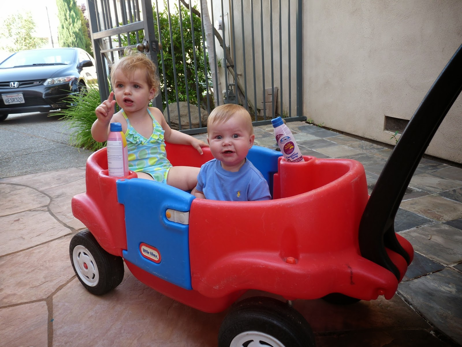 Freddie off to the pool with Lucia  in the wagon
