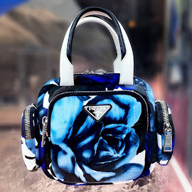 Color ahead with a Prada floral bag.