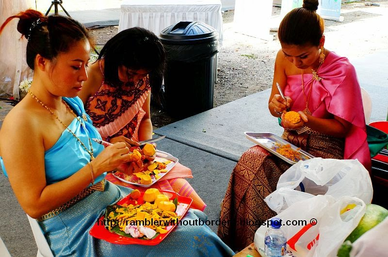 Thai craftswomen doing fruit carving