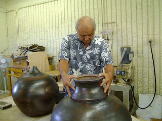 Kauai CC professor Wayne Miyata checks bottom section of sacred ball for the Hall of Compassion