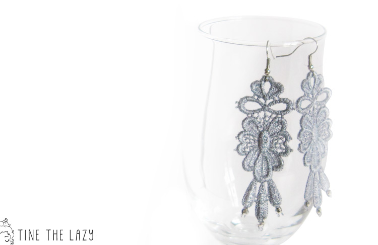 Lightweight earrings made out of grey lace with small crystals.