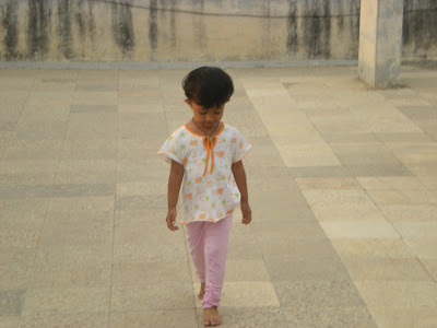 baby girl photograph doing cat walk