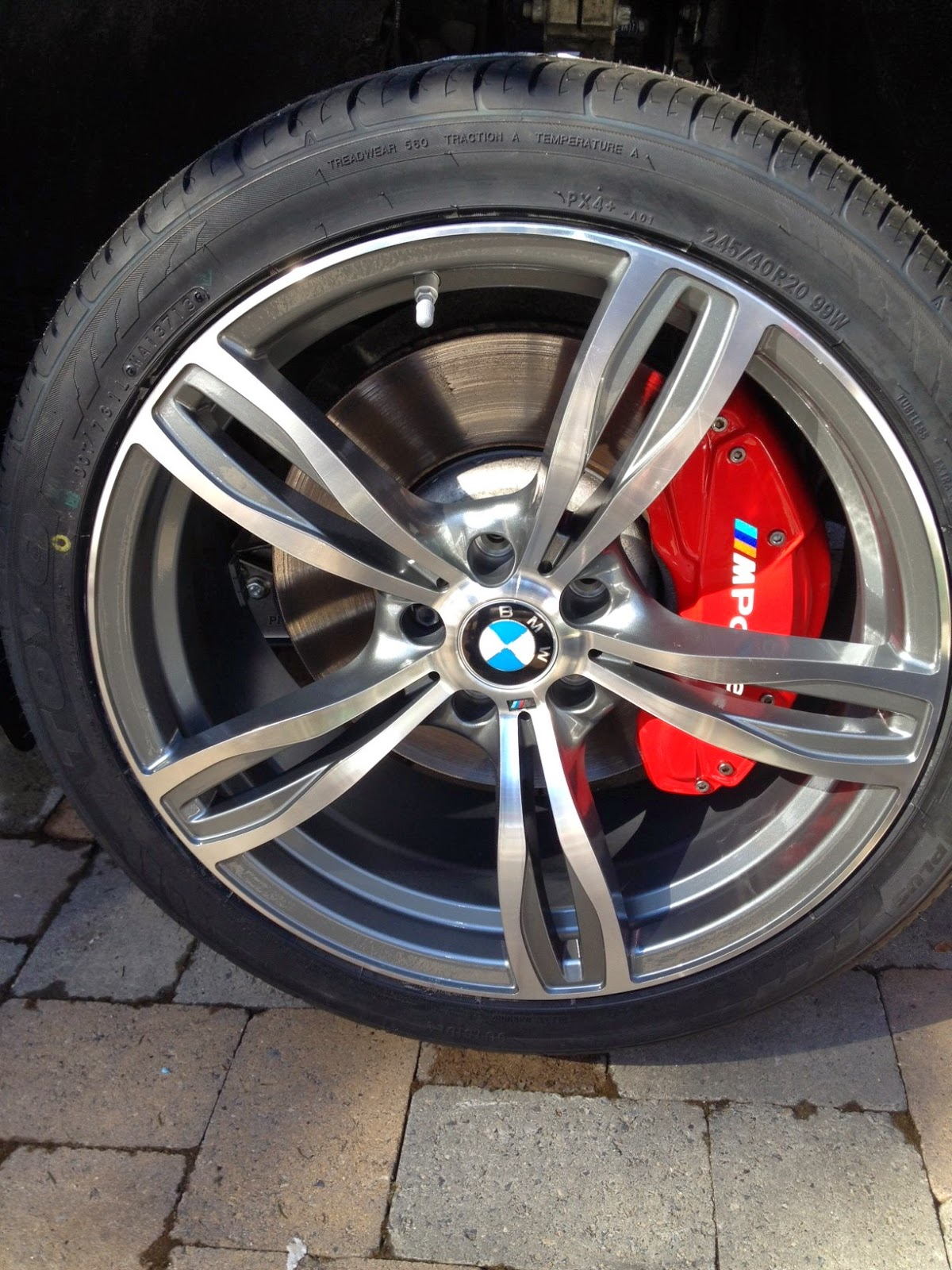 Brake caliper covers on a 2010 bmw 750li red with the colored m power logo