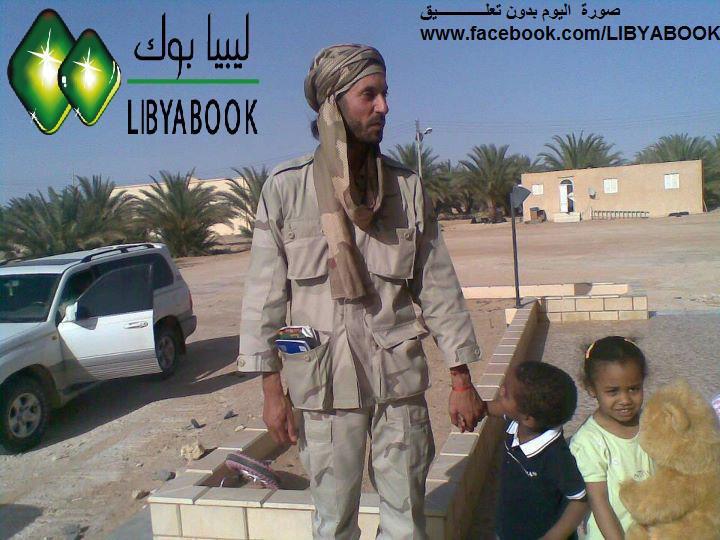 ساهموا معنا في الحمله الوطنيه الاعلاميه لتجميع صور اسره شهيد الوطن الشهيد الصائم Mutassim+Gaddafi