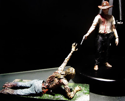 McFarlane Toys The Walking Dead - Rick Grimes and Bicycle Girl Zombie figures