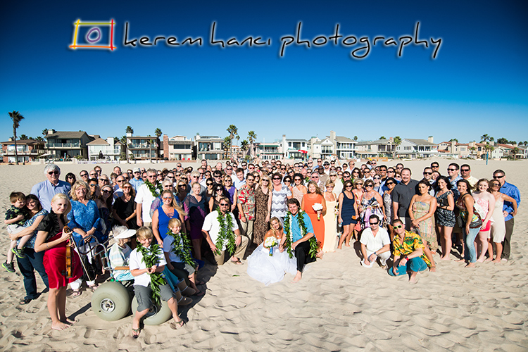 The couple with the guests after their wedding ceremony on the beach