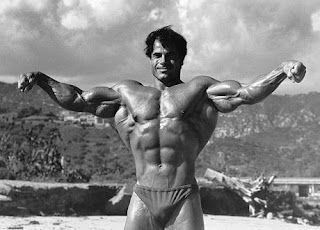 Franco Columbu posing with his huge arms and lats