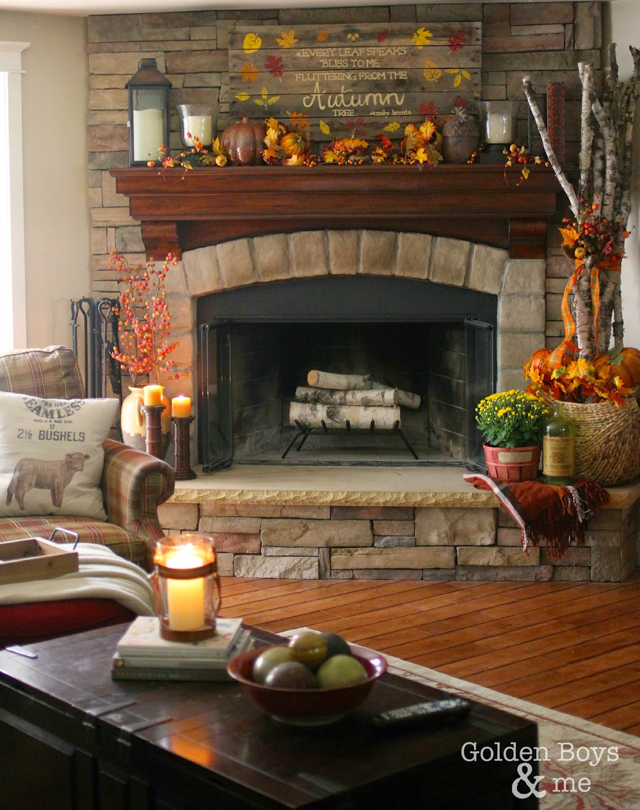 Stone corner fireplace decorated for fall with diy fall pallet sign-www.goldenboysandme.com