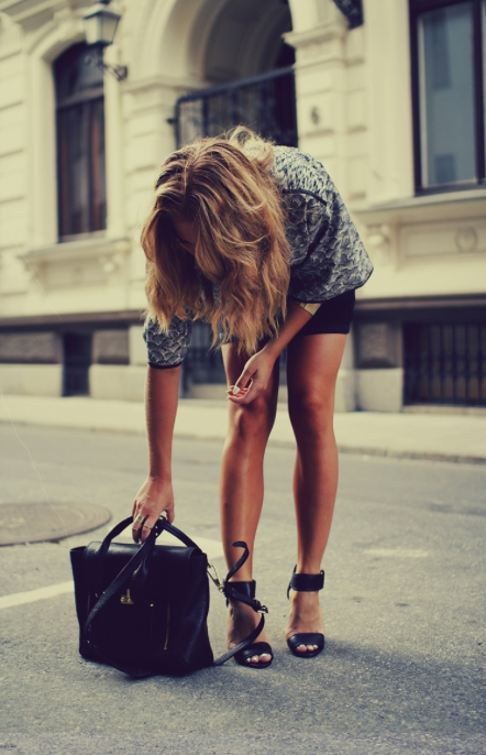Black skirt, high heels, hand bag and shirt for summers