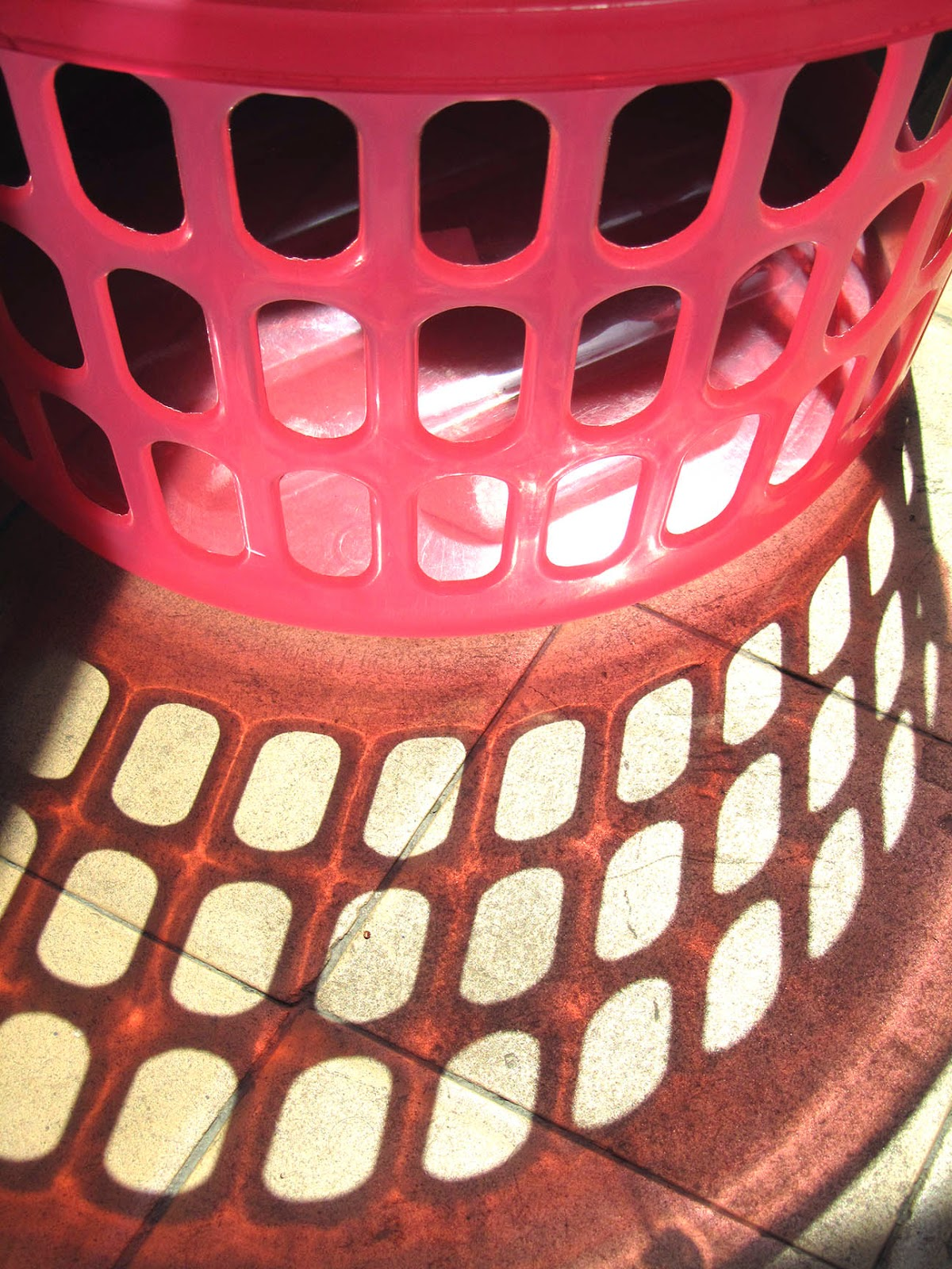 pink laundry basket with shadow