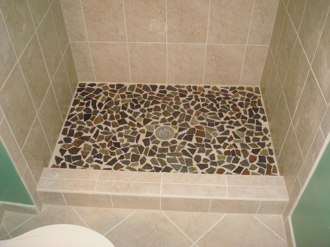 STRAIGHT EDGE TILE Custom Shower With Natural Rock Floor - Ceramic tile that looks like rocks