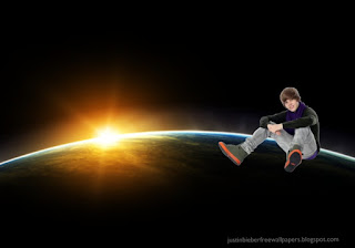 Wallpaper of Justin Bieber Teen Singer photo and wallpaper Justin Bieber sitting in Vatentines Day Concert in classic Space Eclipse background