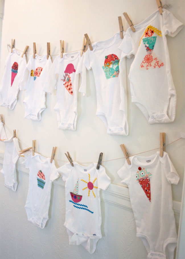 heart pears decorating onesies during baby shower