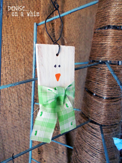 a piece of 2x4, some ribbon and a dab of paint makes the cutest little snowman ornament!