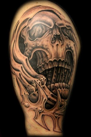 3d tattoo on the shoulder: a human skull
