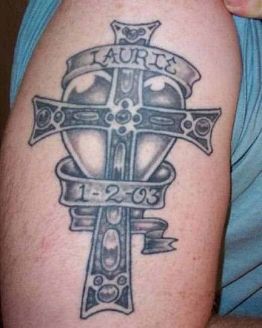 cross with banner tattoo. with names. anner tattoos