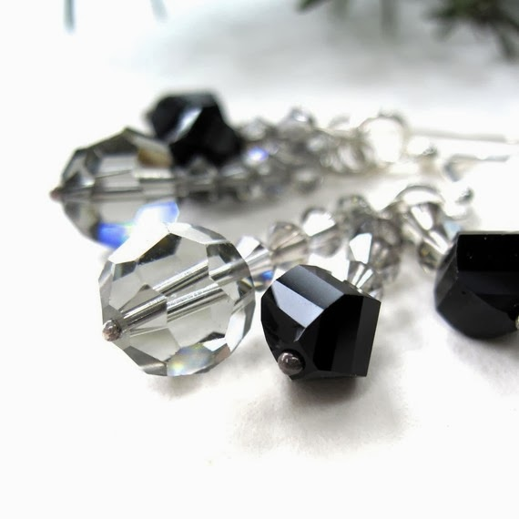 http://www.etsy.com/listing/18890861/jet-black-chandelier-earrings-swarovski