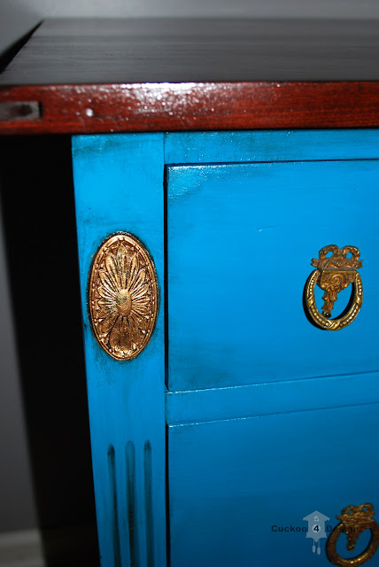 turquoise dresser and gold details
