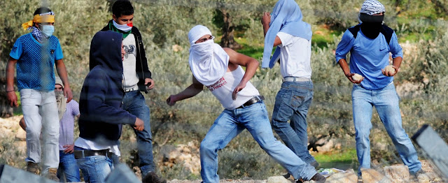 Palestinian Arabs throwing stones