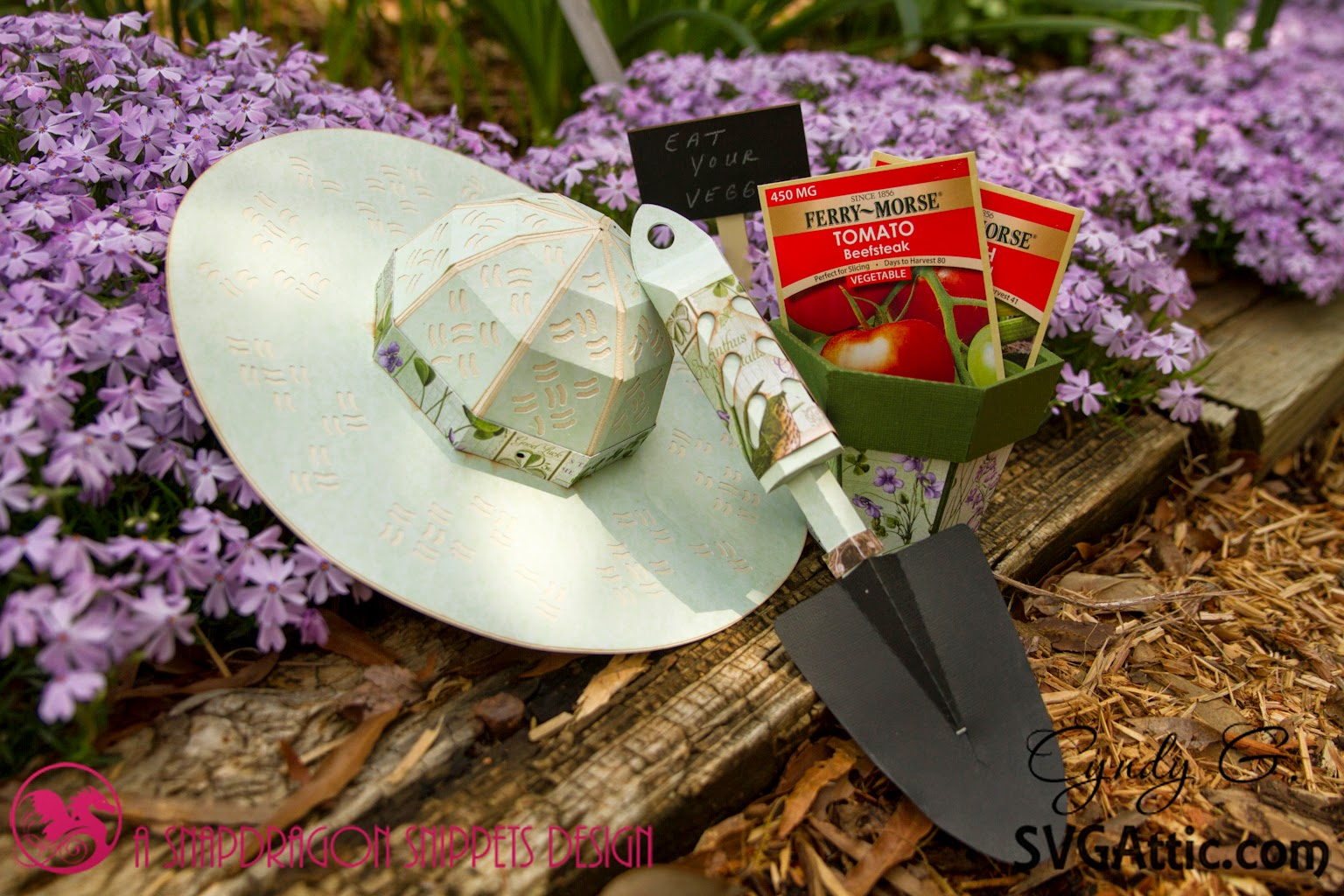 Paper Garden hat, spade and pot in garden