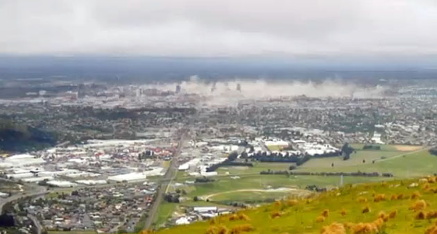 Christchurch city as seen from the Port Hills, taken moments after the February 22nd 2011 6.3 earthquake, with dust rising from the falling buildings in the central business district
