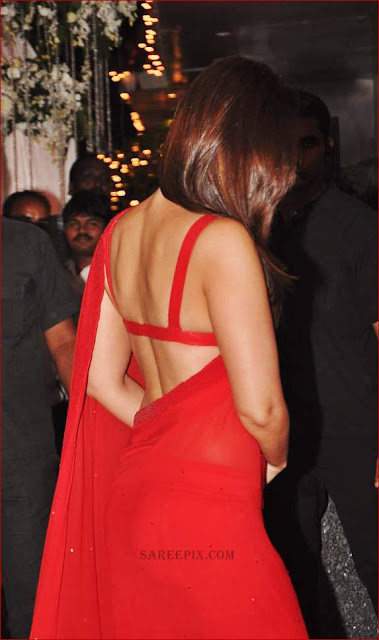 kareena kapoor red strap blouse exposing back in saree