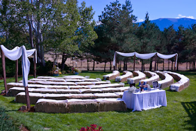 Rustic mountain wedding ceremony with hay bale seating