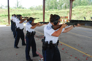 Ten new police recruits, including for SHSU graduates, participate in rifle shooting and the FBI/Conroe Police Department Firearms Training Facility.