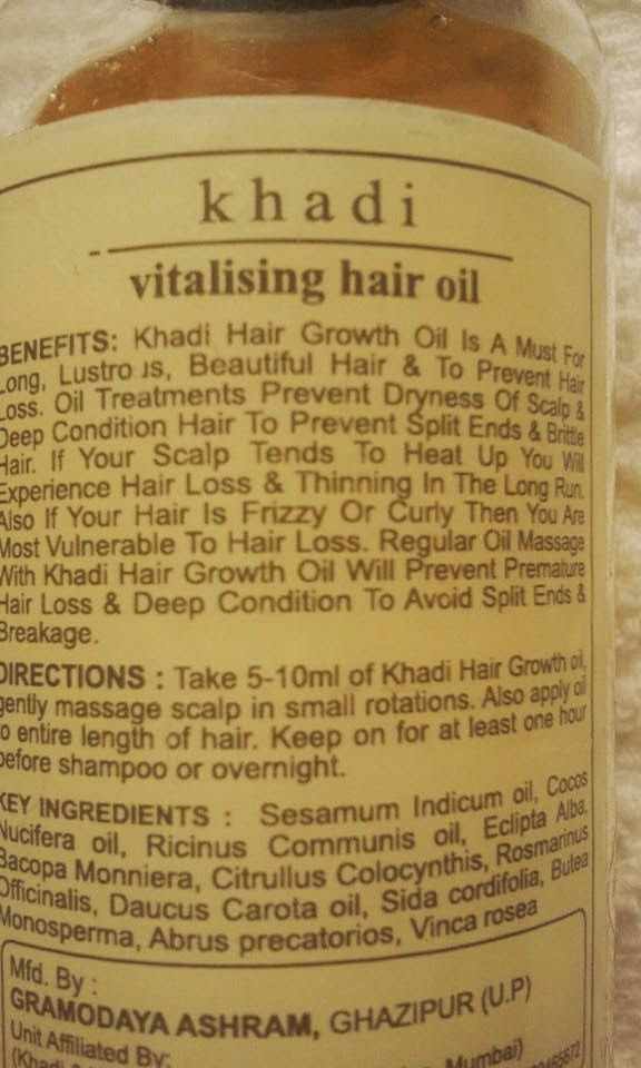 Khadi-Ayurvedic-Oil-vitalising-hair-oil-on-my-table-ingredients-shown