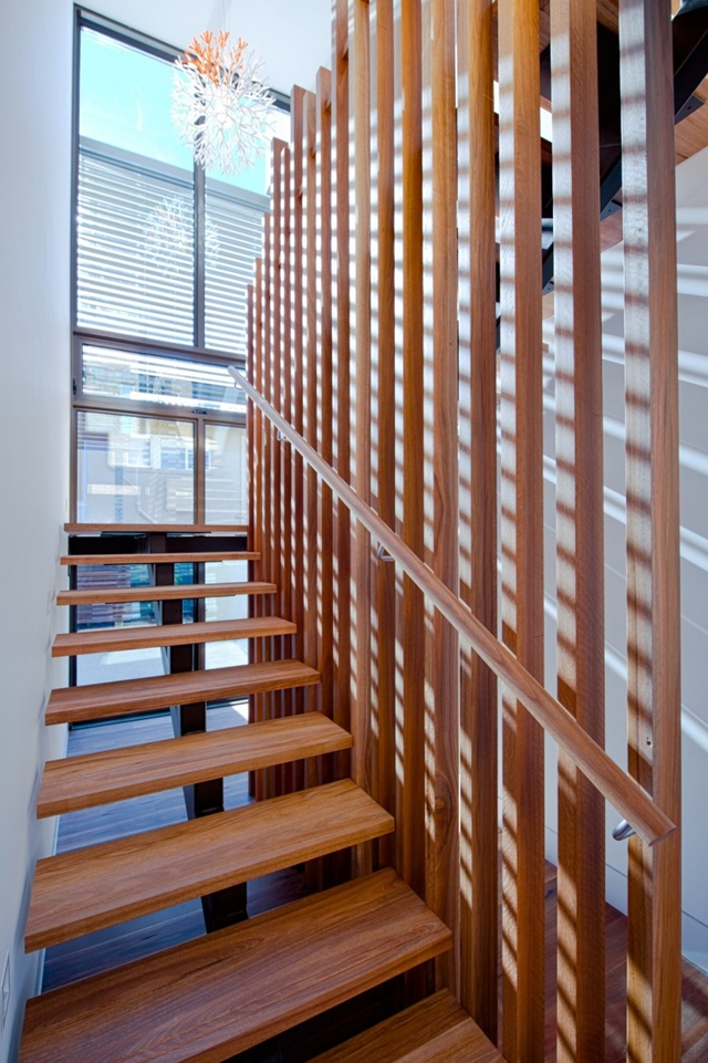 Wooden staircase in the Hill House by Rachcoff Vella Architects
