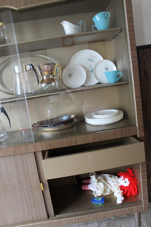 vintage mid century china cabinet with retro china collection